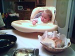 Anna in her new highchair