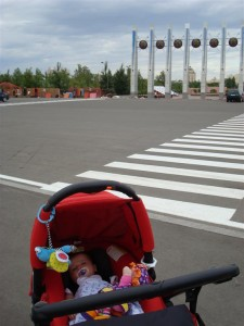 Anna At Entrance To Astana Park, With Yurts In The Background