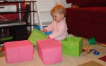 Anna Enjoying Reordering Her Little Toy Boxes