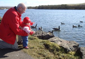 Anna And John By A Lake With Some Birds