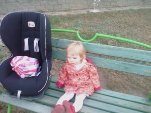 Anna And Her Car Seat Waiting For A Taxi