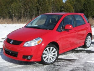 Red Suzuki SX4 Car On Snow