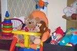 Monkey & Teddy Snuggle Together On Anna's Chair